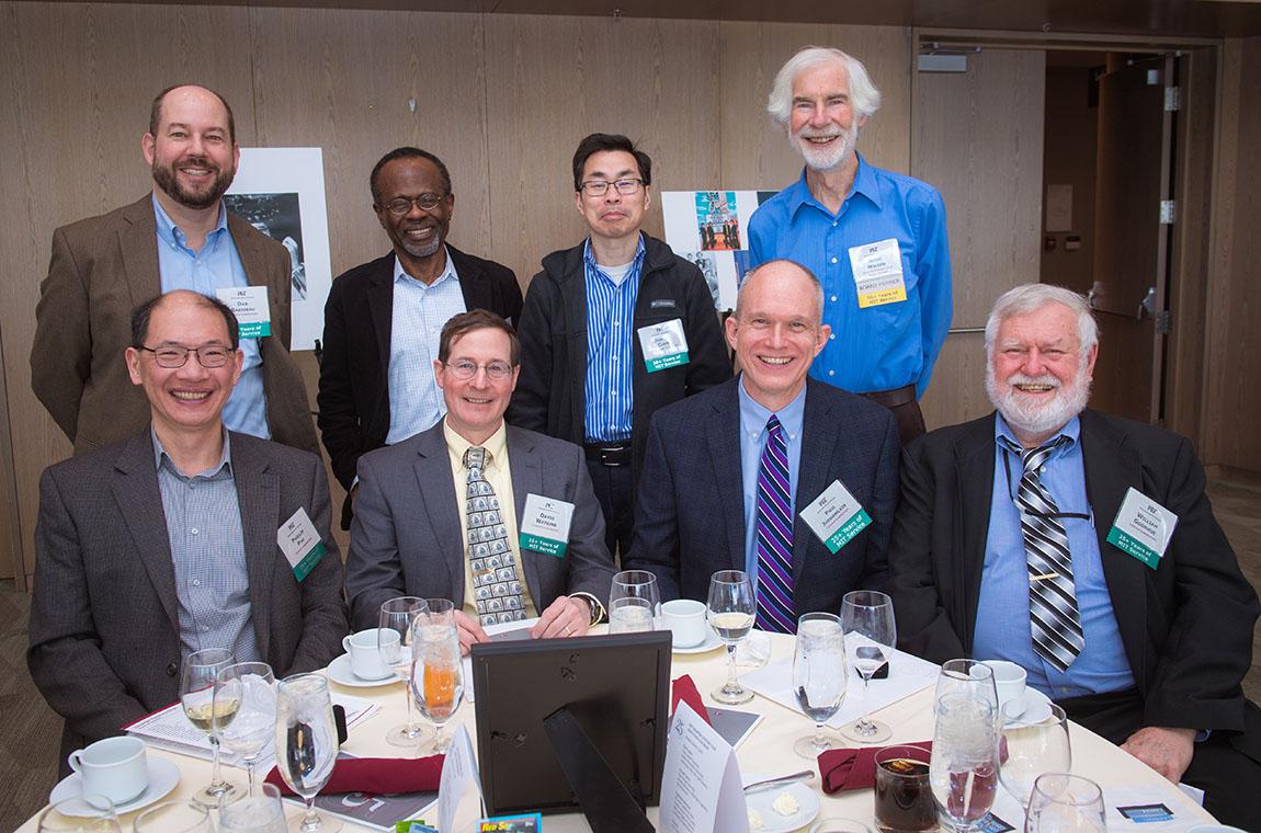 Standing (l-r): Dan Rabideau, Jean Piou, Jianzhu Chen, and QCC Board member Nigel Williams. Seated (l-r): Phillip Phu, David Watkins, Paul Juodawlkis, and William Goodhue