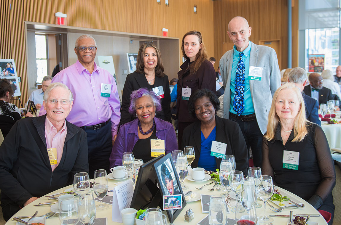 Standing (l-r): Clayton Ward, VP for Human Resources Ramona Allen, Heather Williams, and Alexander Byrne. Sitting (l-r): 50-year achiever Roy Welsch, QCC President Yvonne Gittens, Beverley Kerr, and Lynette Jones.