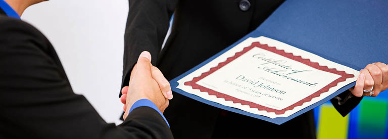 Photo of person receiving a certificate