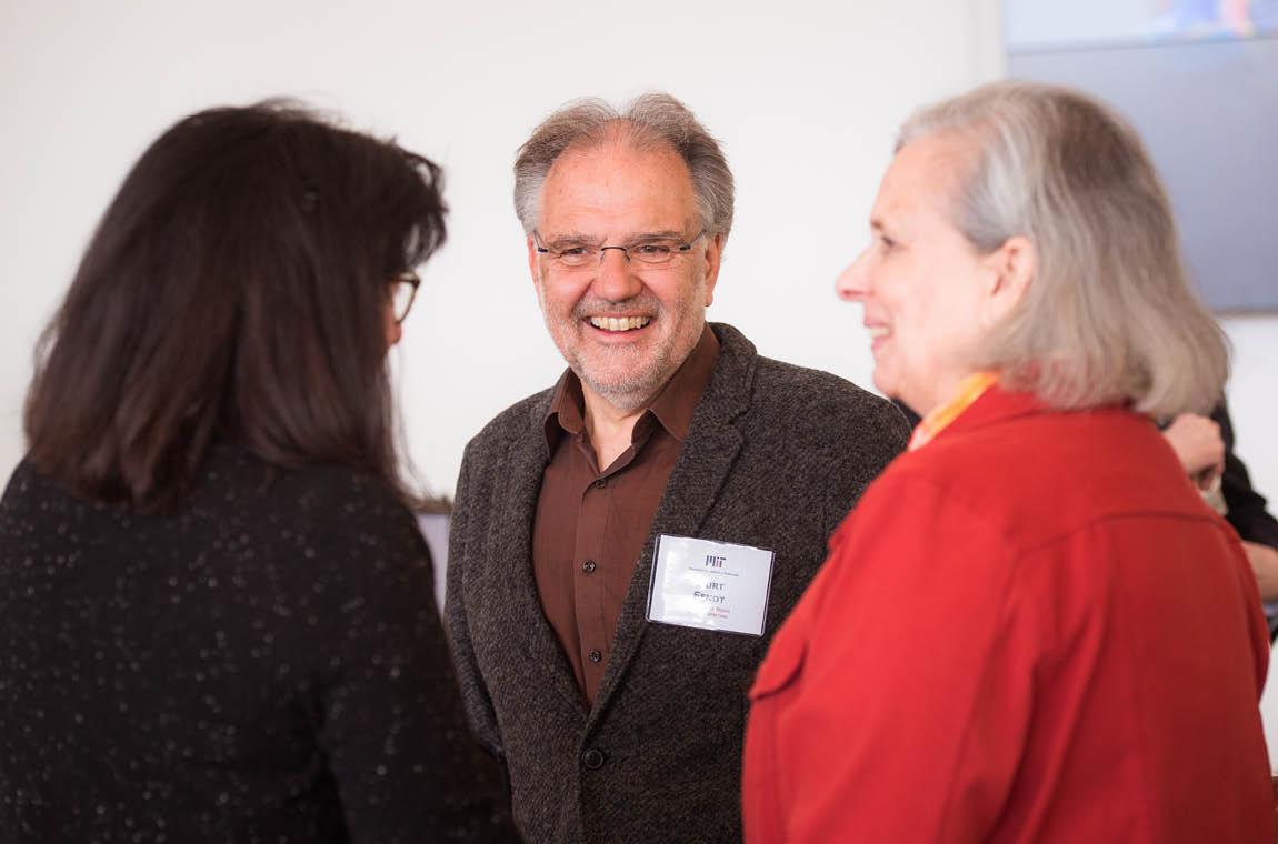 Photo of QCC members Leila Kinney and Kurt Fendt conversing with QCC treasurer Bonny Kellermann