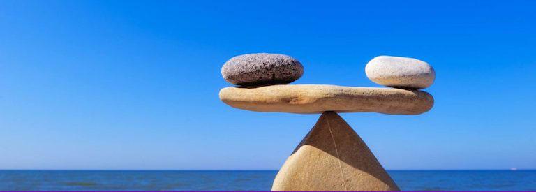 Wellness-balance image of rocks on a see-saw