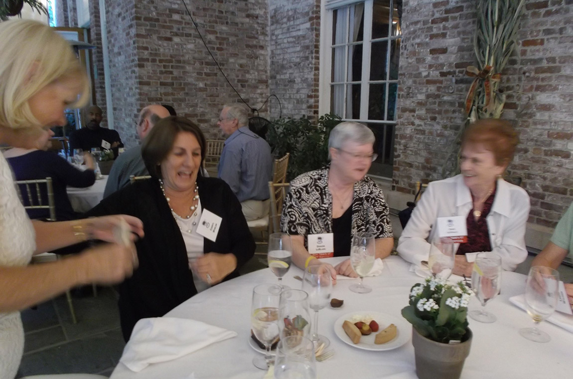 Photo: QCC members and guests conversing over great food